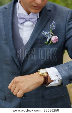 groom in the gray wedding suit at the garden