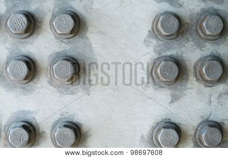 Gray Metal Surface With Hexagonal Bolt Heads