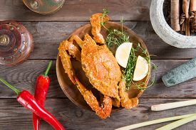 foto of cooked crab  - Top view cooked delicious hot and spicy sauce blue crab and ingredients - JPG