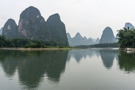 image of early 20s  - the famous 20 yuan banknote scenery taken early in the morning when the li river is calm - JPG