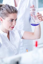 picture of chemistry technician  - Lab technician doing experiment in chemistry laboratory - JPG