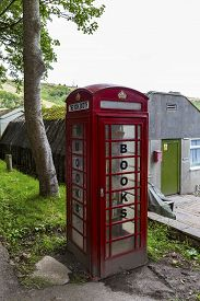 picture of phone-booth  - Showing a phone booth converted to a book share - JPG
