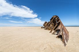 stock photo of barge  - Famous Beach El Barco with sparkling sand and rusty barge in La Pedrera international surfer - JPG
