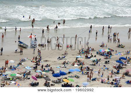 people on crowed beach