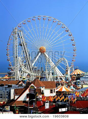 Amusement park rides against blue sky