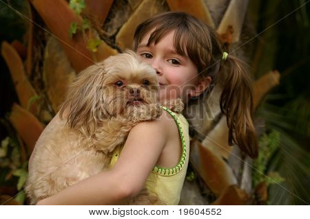A young girl holding her cute puppy