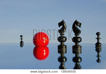 Black Chessmans On Mirror And Ball