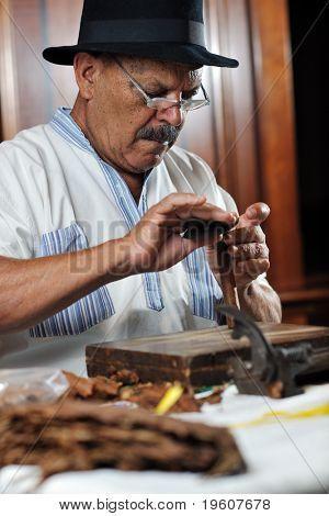 older senior man making luxury handmade cuban cigare