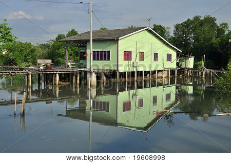wooden house raised building in the swamp
