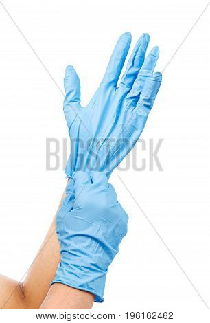 Doctor putting on protective blue gloves isolated on white background. Saved clipping path.