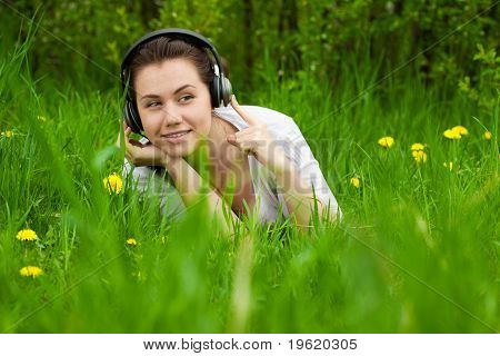 Young Girl With Headphones Looking Right