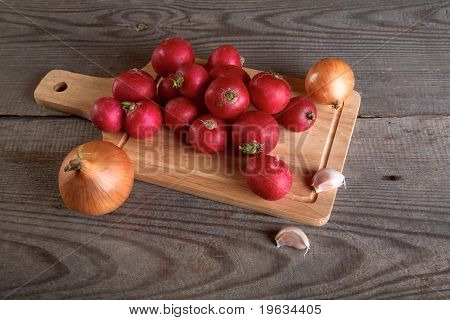 Onions Garlic  Garden Radish On A Table