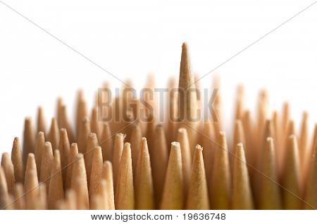Closeup of toothpicks. Shallow focus depth on risen toothpick.