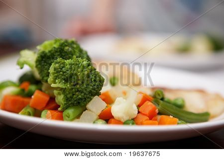 Plate of mixed grilled vegetables. Shallow focus depth on cauliflower