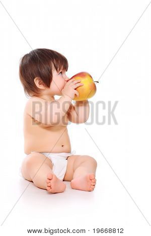 Beautiful baby is eating an apple. Shot in studio. Isolated on white.
