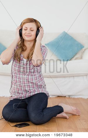 Attractive Blond-haired Woman Listening To Music With Headphones