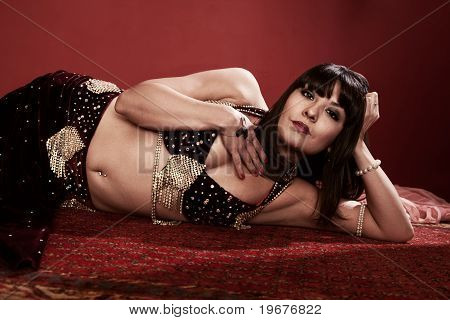 Beautiful Belly Dancer Lying Down
