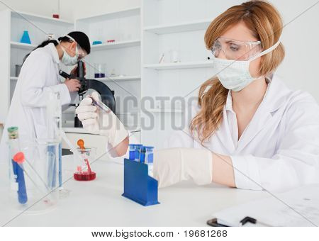 Two Women Conducting An Experiment