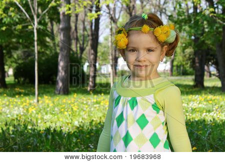 child with flower wreath on head