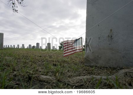 Small american flag by a tombstone