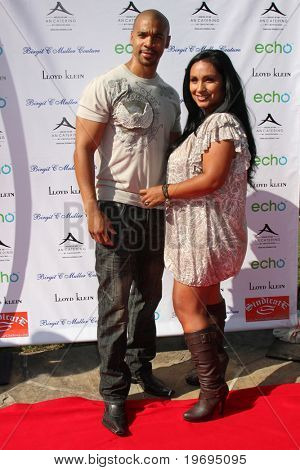 LOS ANGELES  JULY 11: Aaron Spears & wife arrive at the Birgit C. Muller Fashion Show at Chaves Ranch on July 11, 2010 in Los Angeles, CA