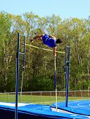 stock photo of pole-vault  - male pole vaulting at a track and field competition - JPG