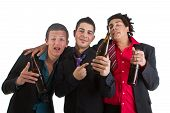 stock photo of underage  - Three young men with business outfit with beer isolated over white - JPG