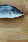foto of cutting board  - Raw fish lying on a chopping borad - JPG