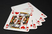 Royal flush poker combination. Shallow focus depth on front sides of cards