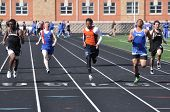 Teen Boys Competing In High School Sprint Race