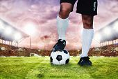 Soccer Or Football Player Standing With Ball On The Field For Kick The Soccer Ball poster