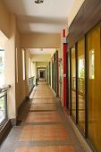 image of commercial building  - Outdoor hallway in a commercial building brick floor - JPG