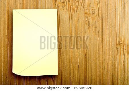 blank sticker glued to a bamboo board