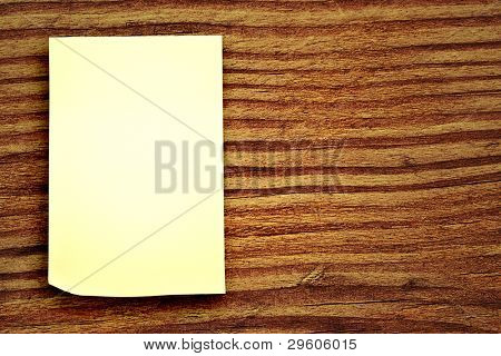 blank sticker glued to a wood background