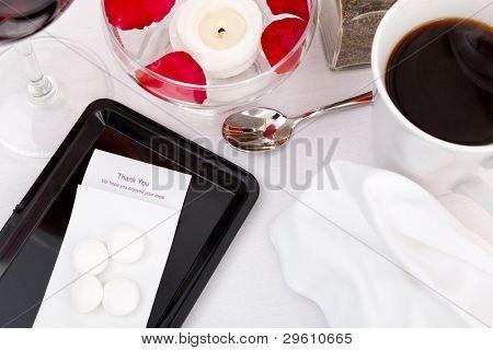 Still life photo of a restaurant bill / check / till receipt on a tray