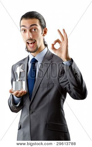 Businessman receiving star award on white