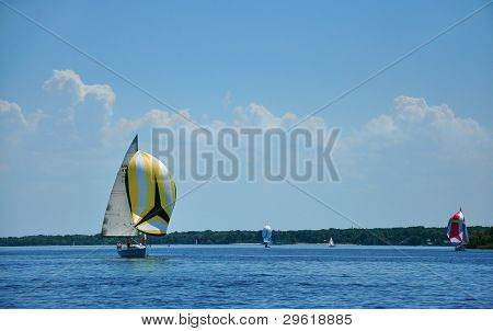 A Yacht With A Yellow Spinnaker