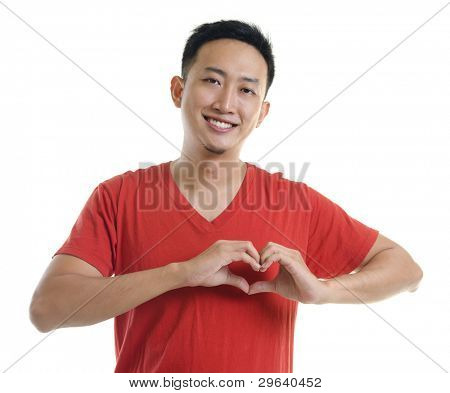 Asian young forming a heart shape on white background