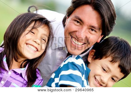 Single parent family portrait looking very happy and smiling