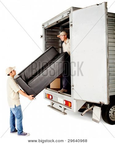 Delivery men with unloading a sofa from a truck - isolated over white