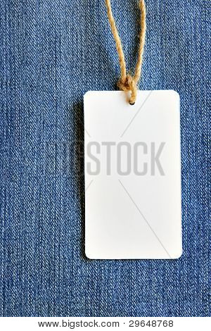 Price tag over jeans background, place your own text here