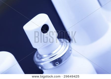 Three spray cans with medication close up