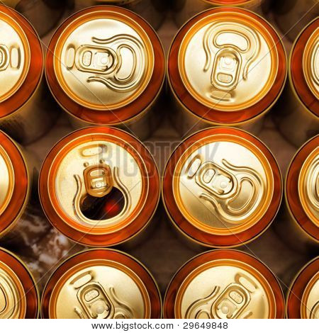 Much of gold beer cans close up