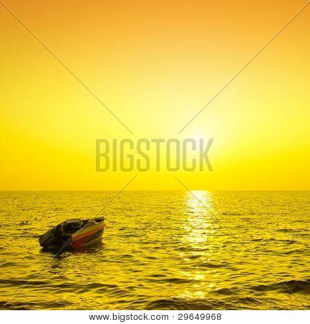 Motor boat and sea at sundown