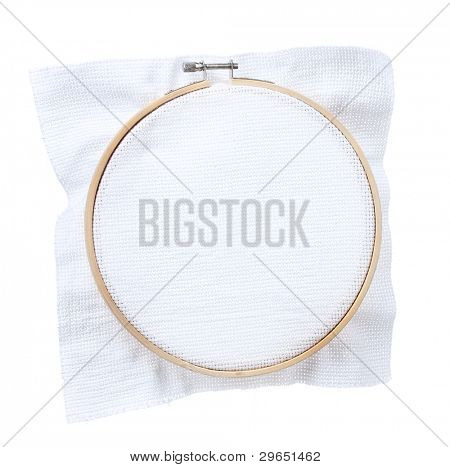 The embroidery hoop with canvas isolated on white