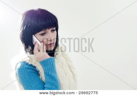 Portrait Of Brunette Girl With Mobile Phone