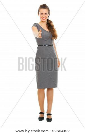 Full Length Portrait Of Business Woman Streching Hand For Handsh