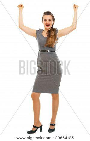 Full Length Portrait Of Female Employee Celebrating Victory