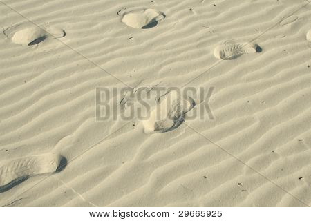 Footprints in the wavy sand