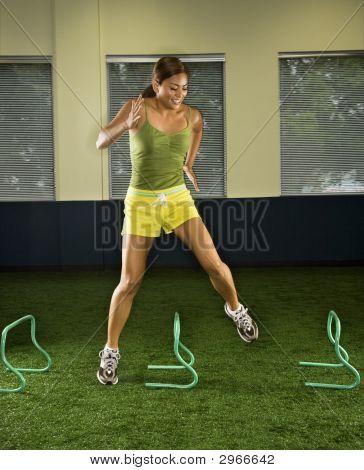Woman Jumping Hurdles.